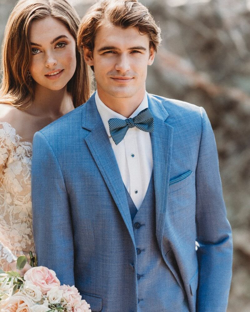 Male model wearing a blue tuxedo